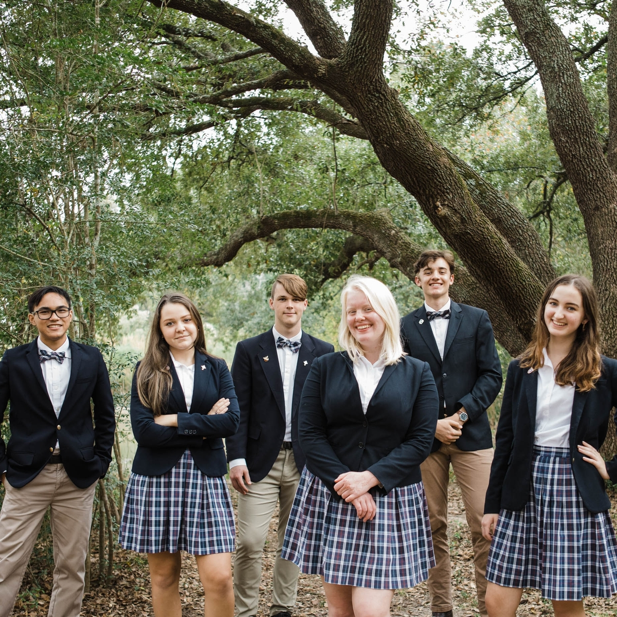 some of the Class of 2021 standing in front of an old oak tree